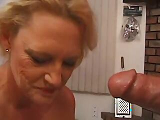 A mature woman has sex on a billiard table in a POV video